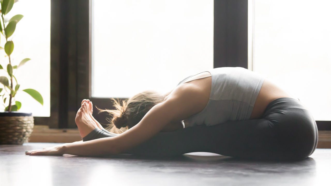 https://livehealthy.ae/wp-content/uploads/2019/08/yoga-forward-bend-1280x720.jpg